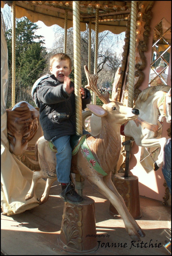 Our little man on a Paris Merry-go-round