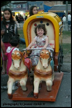 Girl Child enjoying the fun of the fair!