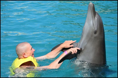 Hubby enjoying a dance with a dophin